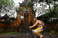 Tourist on bike in Sanur. Bali revisited January 2012.