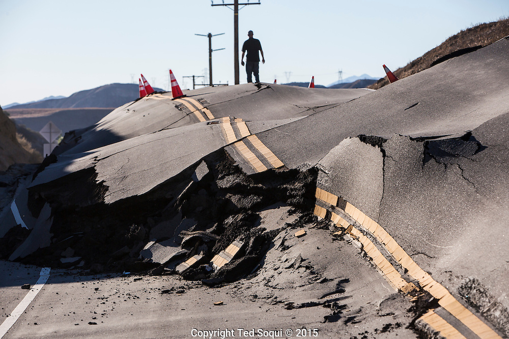 A landslide on Vasquez Canyon road in Santa Clarita continues to move. A small hill next to the roadway keeps pushing forward, uplifting the roadway. The movement may be caused by heavy rains in the area last month which saturated the hill. <br /> Southern California is expected to receive more heavy rains from an El Ni&Ograve;o event off the coast of the California.
