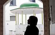 Meyrem Almaci hands out flyers and answers questions of men leaving the mosque after the friday prayer two days before the local elections. Antwerpen, Belgium, 2012