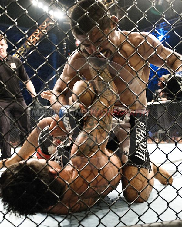 "ABU DHABI, UNITED ARAB EMIRATES, APRIL 10, 2010: Mark Munoz (top) and Kendal Grove are pictured at  ""UFC 112: Invincible"" inside Ferari World, Abu Dhabi on April 10, 2010."