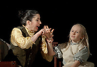 Annie (Nerrissa Bodwell) begins to teach Helen (Sophia Joyal) sign language during Wednesday nights dress rehearsal for Laconia Streetcar Company's upcoming production of The Miracle Worker at the Laconia High School.  (Karen Bobotas/for the Laconia Daily Sun)