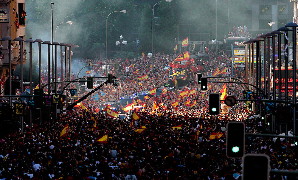 The bus carrying the Spanish team drives through the crowd by Madrid's Plaza de Espana on Monday, July 12, 2010. Spain won the World Cup after defeating the Netherlands 1-0 on Sunday.
