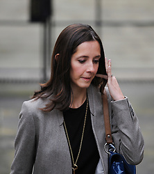 © London News Pictures. FILE PICTURE DATED  21/11/2011. London, UK.  Lawyer, Carine Patry Hoskins who is trending on twitter as  #thewomanontheleft  arriving at The Royal Courts of Justice yesterday (21/11/2011) to give evidence at the Leveson Inquiry into press standards. The inquiry is being lead by Lord Justice Leveson and is looking into the culture, and practice of the UK press. The Leveson inquiry, which may take a year or more to complete, comes after The News of The World Newspaper was closed following a phone hacking scandal. Photo credit : Ben Cawthra/LNP
