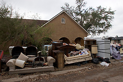 07 Oct, 2005.  New Orleans, Louisiana. Hurricane Katrina aftermath. <br /> Virtually the entire contents of a house in the Gentilly neighbourhood lie on the street following the devastating floods.<br /> Photo; ©Charlie Varley/varleypix.com