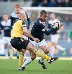 Livingston Simon Mensing tackles Falkirk's Phil Roberts.<br />