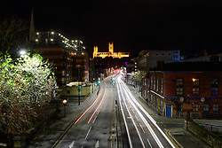Lincoln at Night: Trails of lights created by cars in Broadgate, Lincoln, with Lincoln Cathedral on the horizon.<br /> <br /> Picture: Chris Vaughan Photography<br /> Date: November 29, 2018