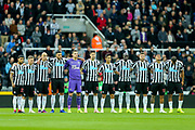 Newcastle United players observe the minute of respect for Leicester City owner Vichai Srivaddhanaprabha, who passed away in a helicopter crash at the King Power Stadium on Saturday 27th October 2018, ahead of the Premier League match between Newcastle United and Watford at St. James's Park, Newcastle, England on 3 November 2018.
