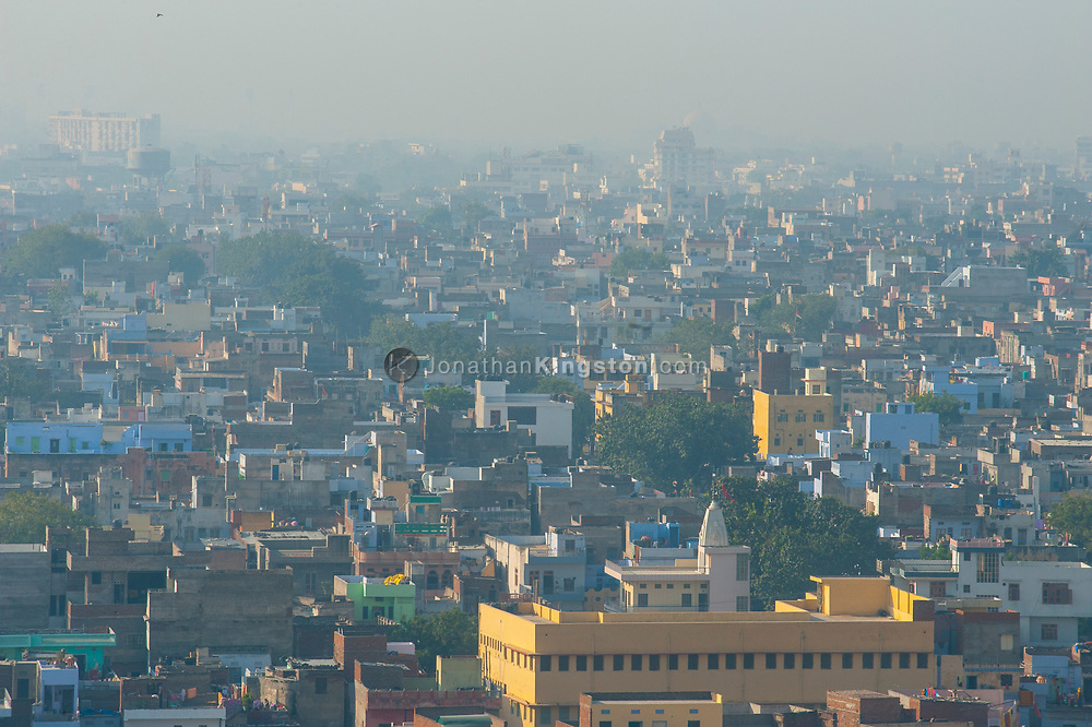 Smoggy daytime view of the skyline of Jaipur, India.