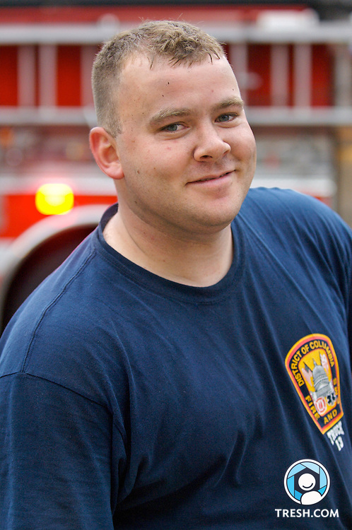 District of Columbia firefighter Jay Bureau poses for a portrait after being called to fight a fire in two roughly 150-square-foot rooms of the basement parking garage of Lofts 11, a condominium building under construction at 1123 11th Street, NW, in Washington D.C.