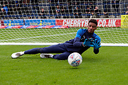 AFC Wimbledon goalkeeper Nathan Trott (1) warming up during the EFL Sky Bet League 1 match between AFC Wimbledon and Lincoln City at the Cherry Red Records Stadium, Kingston, England on 2 November 2019.