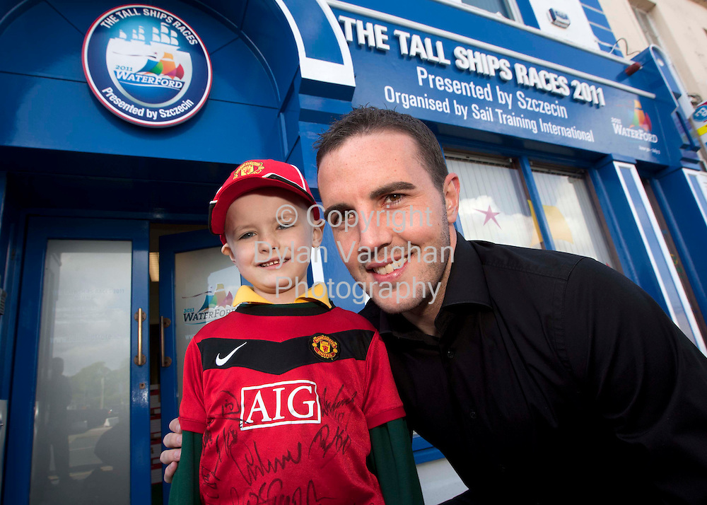 14/5/2010.free picture no charge for reproduction.Pictured at the opening of the new Tall Ships Races 2011 office in Waterford were: from left seven-year-old Ben Meagher, Prospect Mews, Waterford and Manchester Utd star John O'Shea..Picture Dylan Vaughan.