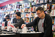 Sonny Banh of San Jose looks at back issues of comic books during Free Comic Book Day at Black Cat Comics in Milpitas, California, on May 6, 2017. (Stan Olszewski/SOSKIphoto)