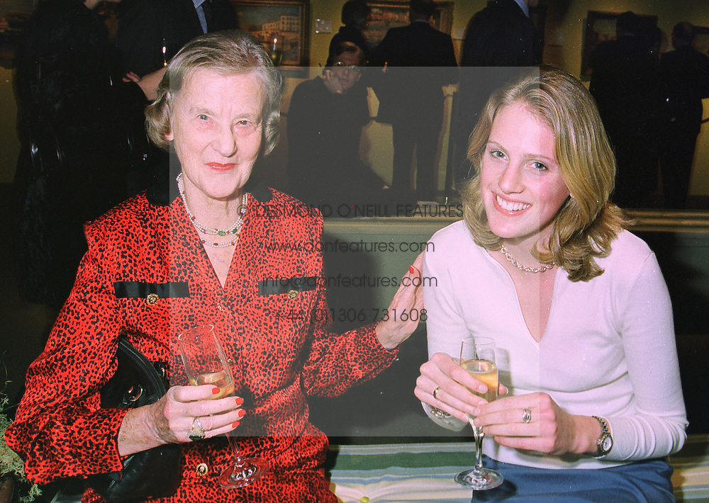 Left to right, LADY REIGATE and her granddaughter MISS MELANIE WHITFELD, at an exhibition in London on 8th January 1998.MEL 14