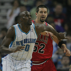 Jan 29, 2010; New Orleans, LA, USA; New Orleans Hornets center Emeka Okafor (50) and Chicago Bulls center Brad Miller (52) fight for position under the basket during the first half at the New Orleans Arena. Mandatory Credit: Derick E. Hingle-US PRESSWIRE