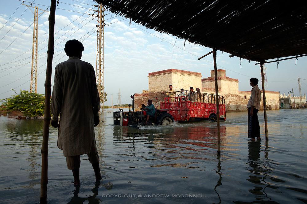 A tractor ferries people through the flooded village of Sultan Kot, in Sindh Province, Pakistan.