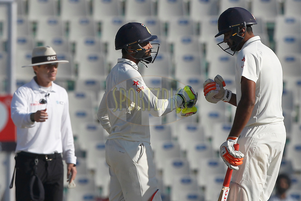 Ravichandran Ashwin of India and Ravindra Jadeja of India during day 3 of the third test match between India and England held at the Punjab Cricket Association IS Bindra Stadium, Mohali on the 28th November 2016.<br /> <br /> Photo by: Deepak Malik/ BCCI/ SPORTZPICS