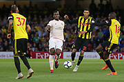 Manchester United Midfielder Paul Pogba battles with Watford midfielder Abdoulaye Doucoure (16) and Watford midfielder Etienne Capoue (29) during the Premier League match between Watford and Manchester United at Vicarage Road, Watford, England on 15 September 2018.