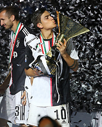 TURIN, May 20, 2019  FC Juventus' Paulo Dybala poses with the trophy during the trophy ceremony at the end of the Serie A soccer match between FC Juventus and Atalanta in Turin, Italy, May 19, 2019. FC Juventus sealed the title with a 2-1 victory over FC Fiorentina on April 20, 2019. (Credit Image: © Fototricarico/Xinhua via ZUMA Wire)