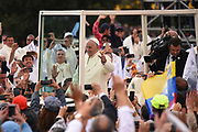 BOGOTA, COLOMBIA 07 SEPT 2017: Pope Francis proceeds through the massive crowds in his Popemobile.