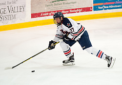 March 11 2016: Robert Morris Colonials forward Zac Lynch (27) skates with the puck during the first period in game one of the Atlantic Hockey quarterfinals series between the Bentley Falcons and the Robert Morris Colonials at the 84 Lumber Arena in Neville Island, Pennsylvania (Photo by Justin Berl)