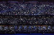 Camera flashes twinkle as torches held by attendants to the Paralympic Games opening ceremony light the National stadium, also known as the Bird's nest in Beijing , China, Saturday, Sept.6, 2008. (Elizabeth Dalziel)