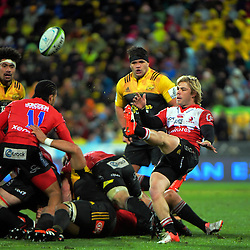 Faf de Klerk puts up a box kick during the Super Rugby final match between the Hurricanes and Lions at Westpac Stadium, Wellington, New Zealand on Saturday, 6 August 2016. Photo: Dave Lintott / lintottphoto.co.nz
