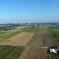 EN&gt; Agricultural fields near Schiphol airport. |<br /> SP&gt; Campos de cultivo cerca del aeropuerto de Schiphol.