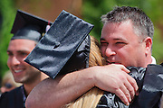 Taylor Kopf, an Ohio University Class of 2013 graduate, hugs her uncle Jeff Gill after the morning commencement ceremony was finished Saturday, May 4, 2013. The commencement ceremonies were held in the Convocation Center in two different shifts at 9 a.m. and 2 p.m.
