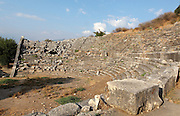 Theatre, built 2nd century BC and amended 2nd century AD, Letoon, near Xanthos, Antalya, Turkey. The theatre is well preserved and has vaulted passages leading to entrances on either side. It was used for religious performances and festivals. The central part of the auditorium was carved from natural bedrock and the aisles made from ashlar. The Letoon or Sanctuary of Leto was the sacred cult centre of Lycia, its most important sanctuary, and was dedicated to the 3 national deities of Lycia, Leto and her twin children Apollo and Artemis. Leto was also worshipped as a family deity and as the guardian of the tomb. The site is 10km South of the ancient city of Xanthos in Lycia, near the modern-day village of Kumluova, Fethiye. Founded in the 6th century BC, the Greek site also flourished throughout Roman times, and a church was built here in the Christian era. The site was abandoned in the 7th century AD. Picture by Manuel Cohen