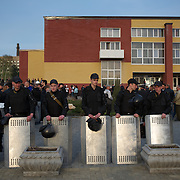 Ukrainian riot policemen take guard at a pro-Ukraine rally in central Donetsk.