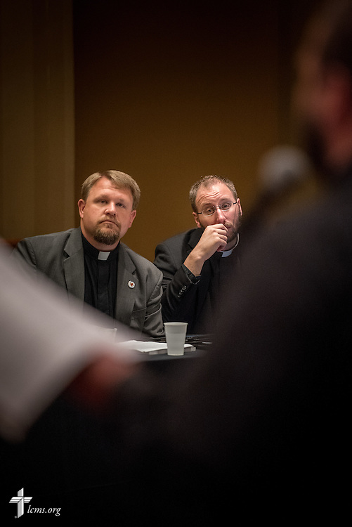 "The Rev. Ryan David Wendt and the Rev. Sean Daenzer  listen during an open hearing of Floor Committee #5 ""Theology and Church Relations"" at the 66th Regular Convention of The Lutheran Church–Missouri Synod on Saturday, July 9, 2016, in Milwaukee. LCMS/Michael Schuermann"