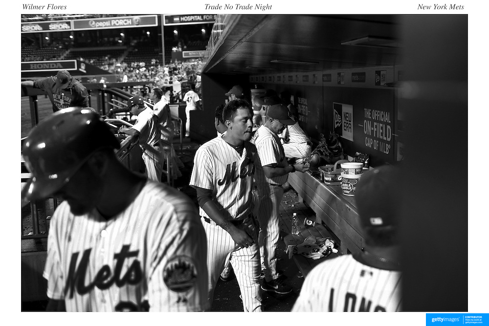 The lonely figure of Wilmer Flores, New York Mets, in the dugout as he collects his helmet after being pulled from the game while crying after he thought he had been traded during the New York Mets Vs San Diego Padres MLB regular season baseball game at Citi Field, Queens, New York. USA. 29th July 2015. Photo Tim Clayton