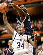 Syracuse Orange forward (34) Demetris Nichols has a shot blocked by Connecticut Huskies forward (11) Hilton Armstrong during the first half of the game at the Carrier Dome in Syracuse, NY on Jan. 16, 2005.