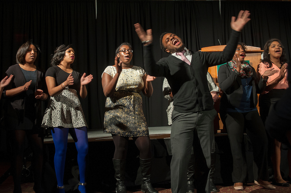 Jeffrey Billingsley of Alpha Phi Alpha Fraternity, leads a group of singers at the conclusion of the 15th annual Martin Luther King Jr. Day Brunch on Monday, January 19 in Baker University Center Ballroom.
