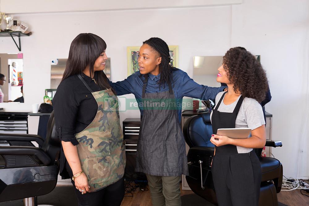 September 10, 2016 - Ca, CA - Female barbers having team discussion in barber shop (Credit Image: © Alyson Aliano/Image Source via ZUMA Press)