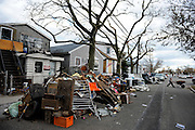 Nick Stack wheels a load of Hurricane Sandy debris from a friend's yard in Broad Channel, N.Y., Nov. 3, 2012.