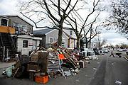 Nick Stack wheels a load of Hurricane Sandy debris from a friend's yard in Broad Channel, N.Y., Nov. 3, 2012.