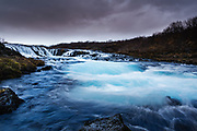 Bruarfoss, under cloudy skies, one of the many waterfalls to be found in Iceland.<br /> Available as an A3+ limuted edition Matt print or an A3 lustre/glossy print. Will normally be printed on William Turner fine art paper, unless the lustre glossy option is chosen. Edition will be limited to 200 prints.