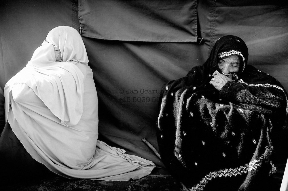 Widows waiting to get paid a compensation by the Pakistani goverment.<br /> Balakot, Dec. 2005
