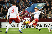 Aston Villa striker(on loan from Chelsea) Tammy Abraham (18) takes a shot at goal during the EFL Sky Bet Championship match between Aston Villa and Nottingham Forest at Villa Park, Birmingham, England on 28 November 2018.