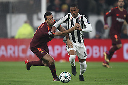 November 22, 2017 - Turin, Italy - Juventus forward Douglas Costa (11) fights for the ball against Barcelona midfielder Sergio Busquets (5) during the Uefa Champions League group stage football match n.5 JUVENTUS - BARCELONA on 22/11/2017 at the Allianz Stadium in Turin, Italy. (Credit Image: © Matteo Bottanelli/NurPhoto via ZUMA Press)