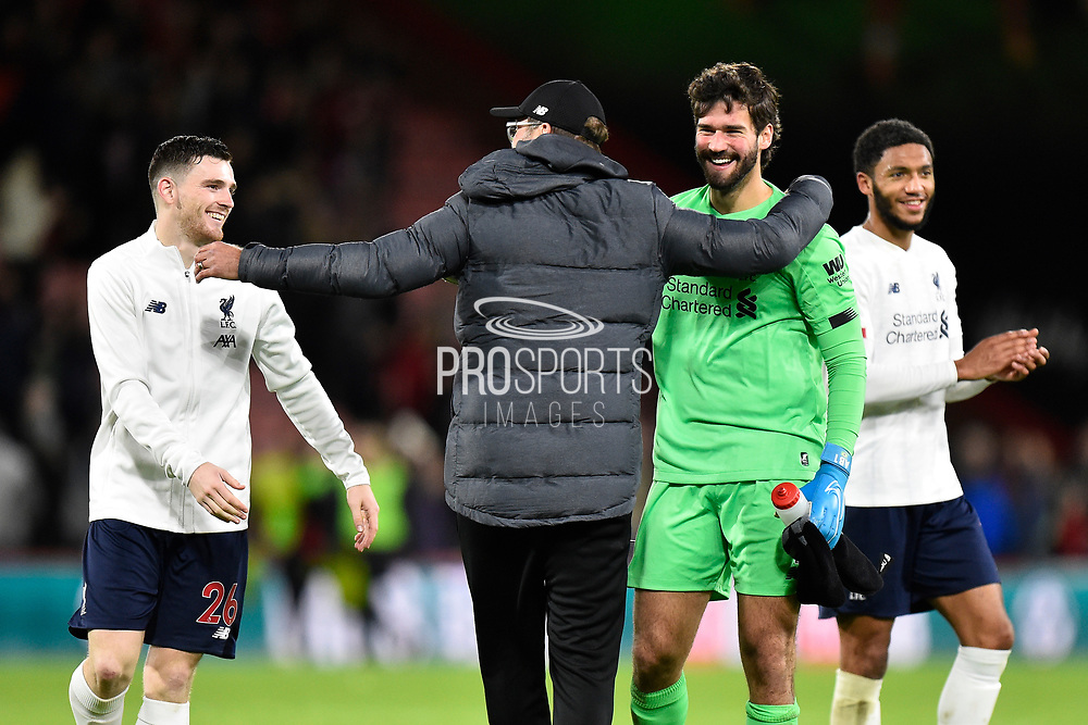 Liverpool manager Jurgen Klopp celebrates the 3-0 win with Andrew Robertson (26) of Liverpool and Alisson Becker (1) of Liverpool at full time during the Premier League match between Bournemouth and Liverpool at the Vitality Stadium, Bournemouth, England on 7 December 2019.