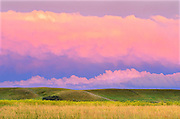 Grasslands at sunset with brewing storm (West Block)<br /> Grasslands National Park<br /> Saskatchewan<br /> Canada