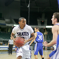 "Pirate guard Timothy ""T.J."" Short drives for a lay up."