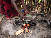Kifene Tadesse, 38, and two of her children prepare some yam and freshly roasted and ground coffee for lunch on an open fire, in her kitchen, Boreda, Ethiopia.