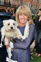 INGRID SEWARD and her dog Puff at A Date With Your Dog At George in aid of the Dogs Trust held at George, 87-88 Mount Street, London on 9th September 2014.