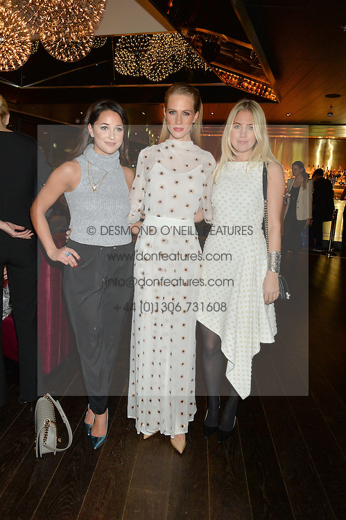 Left to right, ROXIE NAFOUSI, POPPY DELEVINGNE and MARISSA MONTGOMERY at the Launch Of Osman Yousefzada's 'The Collective' 4th edition with special guest collaborator Poppy Delevingne held in the Rumpus Room at The Mondrian Hotel, 19 Upper Ground, London SE1 on 24th November 2014, sponsored by Storm models and Beluga vodka.