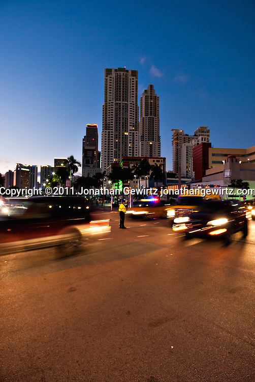 Early morning traffic crossing Biscayne Blvd. near the entrance of the Port of Miami. WATERMARKS WILL NOT APPEAR ON PRINTS OR LICENSED IMAGES.