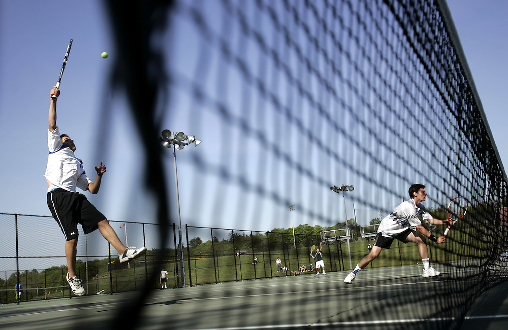 Harrison, NY / 2009 - Sam Gelb and Eric Osman from Edgemont played a doubles match during the Division III tennis tournament at Harrison High School.  ( Mike Roy / The Journal News )