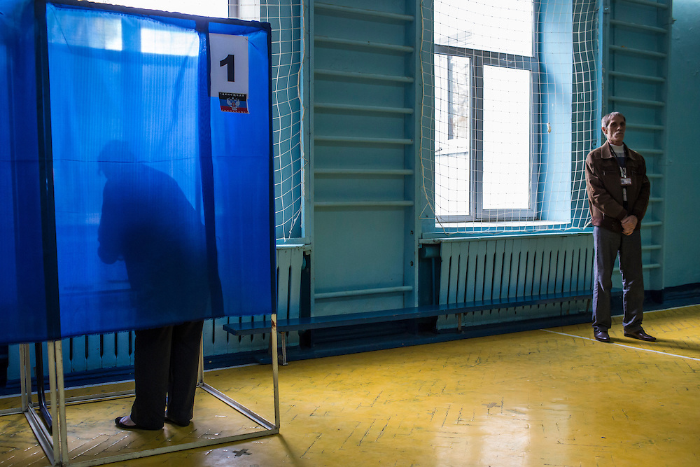 HARTSIZK, UKRAINE - MAY 11: A woman casts her ballot at a polling station on May 11, 2014 in Hartsizk, Ukraine. A referendum on greater autonomy is being held after pro-Russian activists took over at least ten cities in the eastern part of the country in a bid for less control from the central government from Kiev. (Photo by Brendan Hoffman/Getty Images) *** Local Caption ***